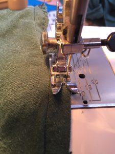 Overcast stitch the seams