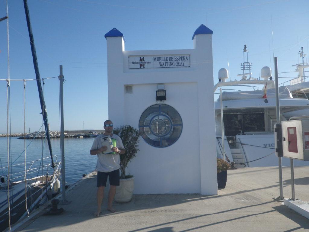 Man waiting at the visitors quay at Estepona marina