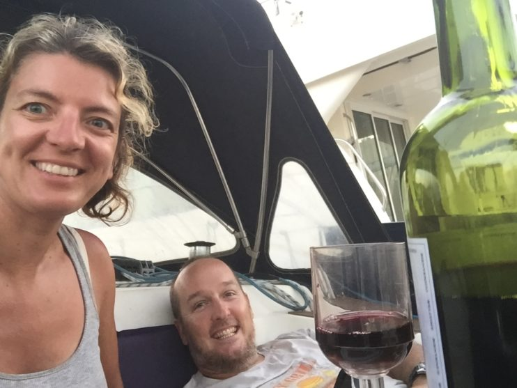 Two people with wineglass and bottle